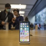 An Apple Inc. iPhone X stands on display at an Apple store during its launch in Hong Kong, China, on Friday, Nov. 3, 2017. Long lines formed outsideApple stores around the world, a sign of strong demand from consumers waiting for the company's10th anniversaryiPhoneX. Photographer: Justin Chin/Bloomberg via Getty Images