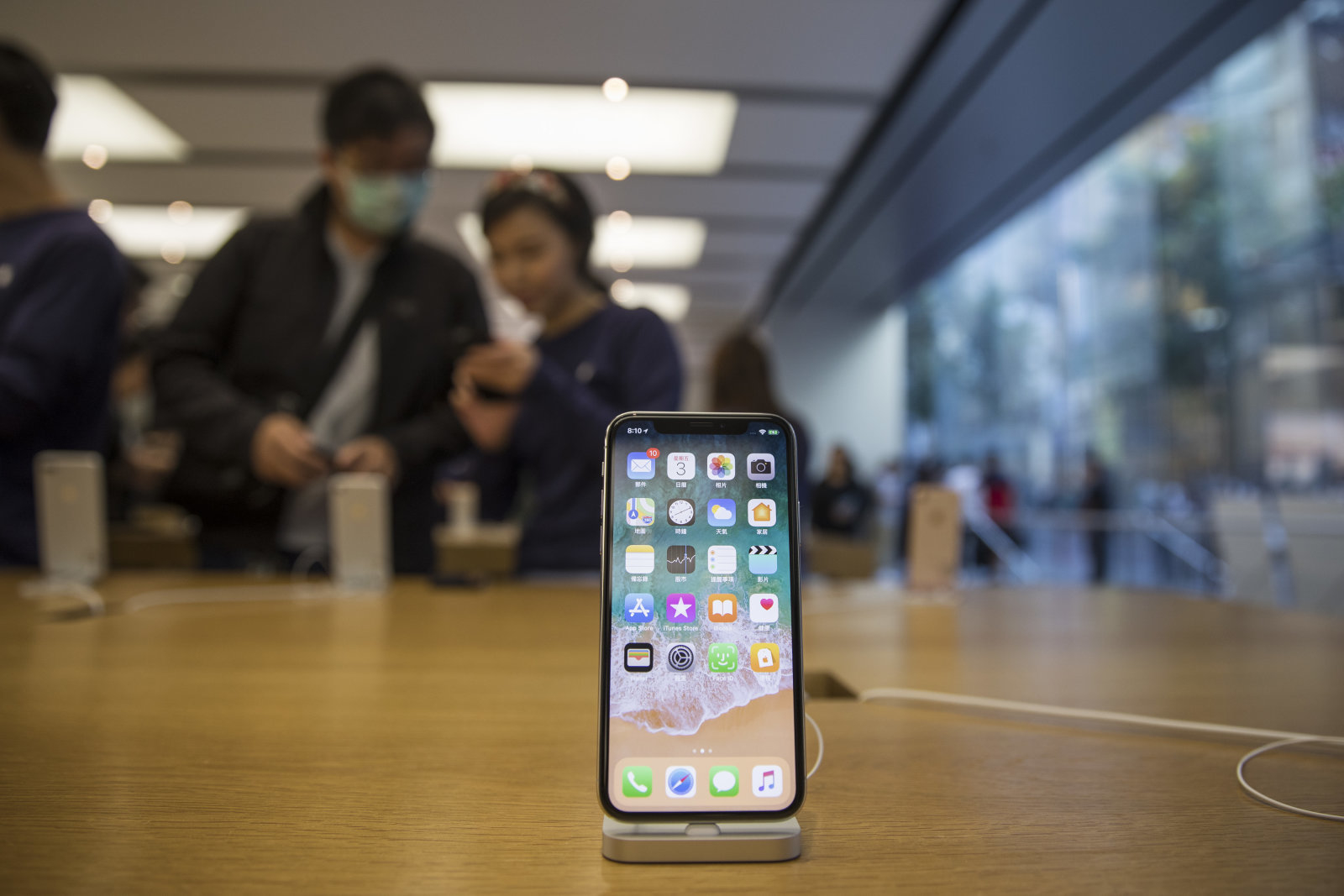 An Apple Inc. iPhone X stands on display at an Apple store during its launch in Hong Kong, China, on Friday, Nov. 3, 2017. Long lines formed outside Apple stores around the world, a sign of strong demand from consumers waiting for the company's 10th anniversary iPhone X. Photographer: Justin Chin/Bloomberg via Getty Images