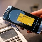A worker demonstrates wireless payment using the Samsung Pay app on a Galaxy smartphone, manufactured by Samsung Electronics Co. Ltd., on the opening day of the Mobile World Congress (MWC) in Barcelona, Spain, on Monday, Feb. 27, 2017. A theme this year at the industry's annual get-together, which runs through March 2, is the Internet of Things. Photographer: Pau Barrena/Bloomberg via Getty Images