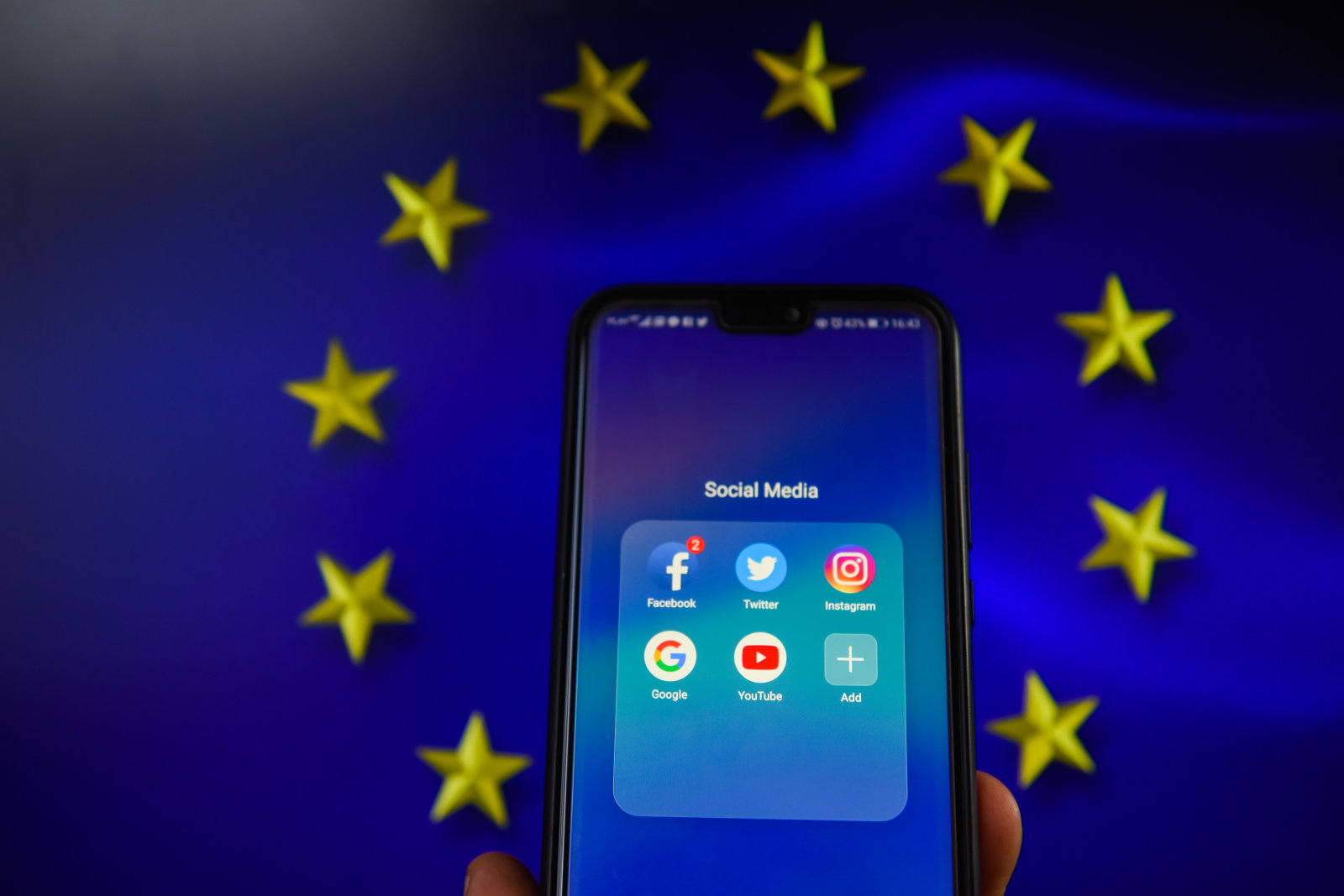 KRAKOW, POLAND - 2018/08/20: Social media apps with European Union flag are seen in this photo illustration. The European Commission is planning issue a regulation that allows to fine social media platforms and websites if they don't delete extremist post within one hour. (Photo by Omar Marques/SOPA Images/LightRocket via Getty Images)