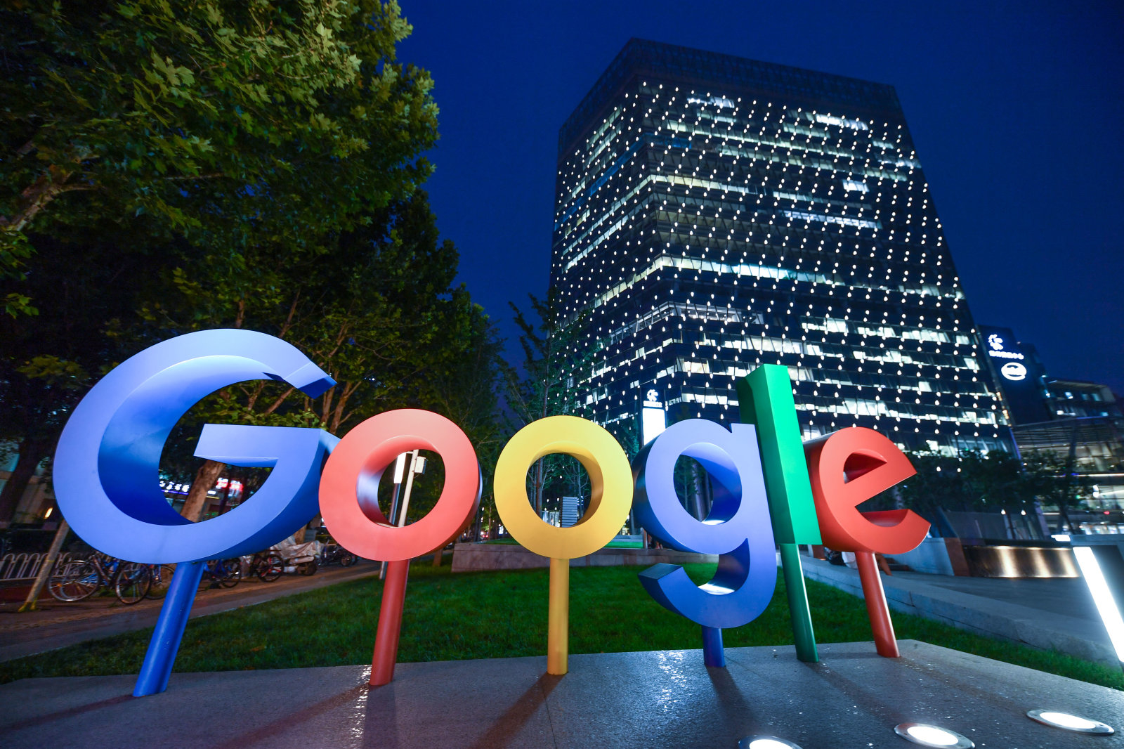 BEIJING, CHINA - AUGUST 07: The Google Inc. logo is illuminated in front of Google Beijing Office on August 7, 2018 in Beijing, China. According to China Daily, Google Inc. plans to offer cloud services in Mainland China, and it is in talks with several Chinese companies, such as Tencent Holdings Ltd and Inspur Group. (Photo by VCG)