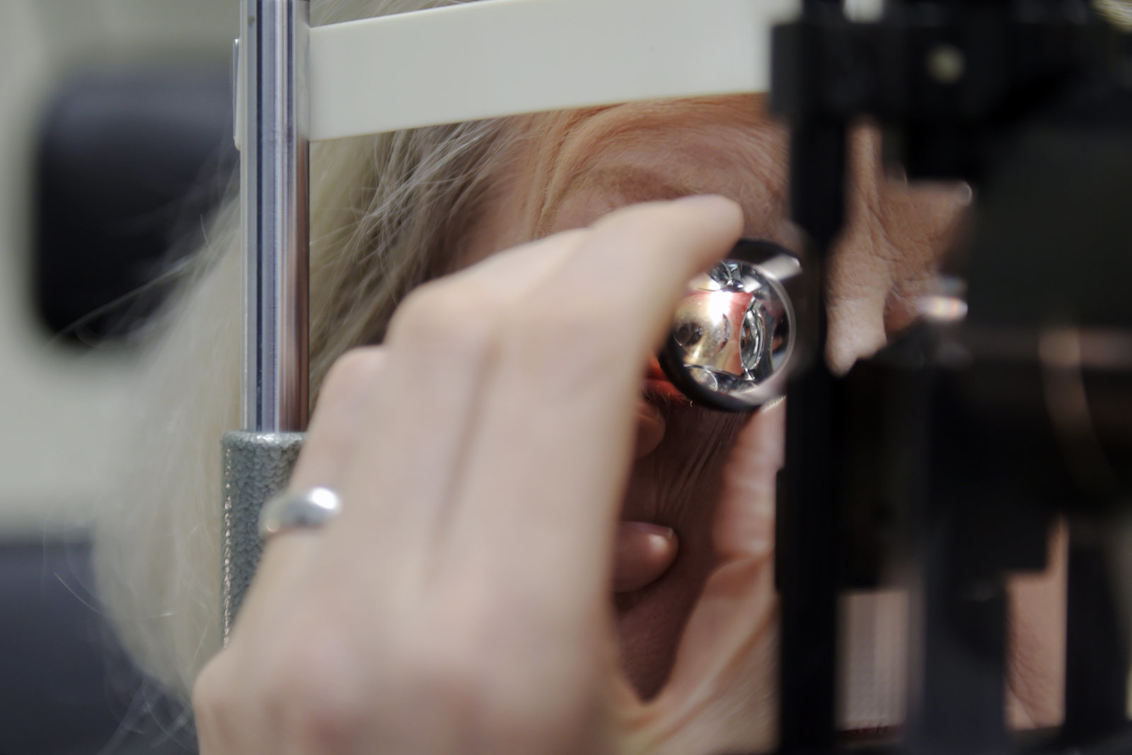 The pupil of a glaucoma patient, the recipient of an ocular implant manufactured by PolyActiva Pty Ltd., is seen through a magnifying lens during an examination at the Center for Eye Research Australia in Melbourne, Australia, on Tuesday, Aug. 21, 2018. The experimental ocular implant for treating glaucoma, the first of its kind, dispenses a constant daily dose of medicine as it dissolves over six months. Photographer: Carla Gottgens/Bloomberg via Getty Images