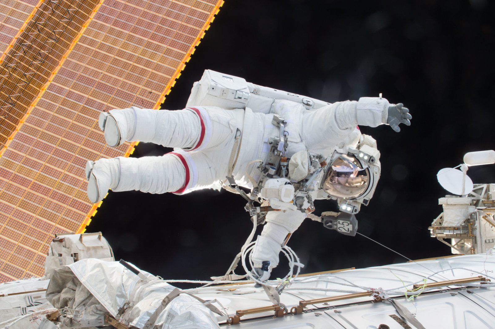 IN SPACE - DECEMBER 21:  In this handout photo provided by NASA, NASA astronaut Scott Kelly is seen floating during a spacewalk on December 21, 2015 in space. NASA astronauts Scott Kelly and Tim Kopra released brake handles on crew equipment carts on either side of the space stations mobile transporter rail car so it could be latched in place ahead of Wednesdays docking of a Russian cargo resupply spacecraft. Kelly and Kopra also tackled several get-ahead tasks during their three hour, 16 minute spacewalk. (Photo by NASA via Getty Images)
