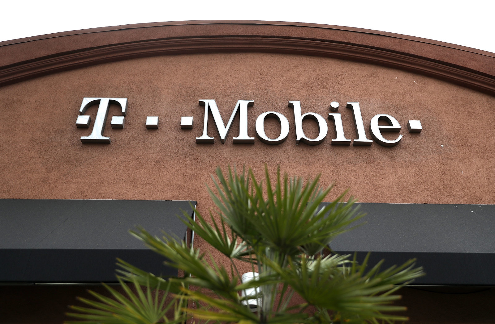 EL CERRITO, CA - APRIL 30:  A sign is posted on the exterior of a T-Mobile store on April 30, 2018 in El Cerrito, California. T-Mobile announced plans to acquire Sprint for $26 billion to merge the two telecom companies. (Photo by Justin Sullivan/Getty Images)