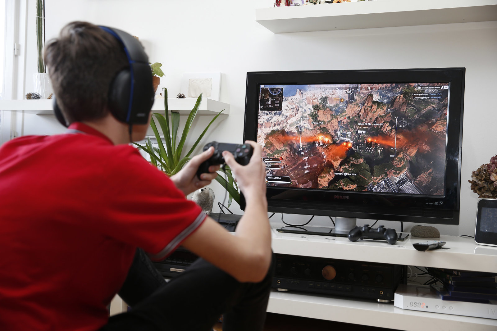 PARIS, FRANCE - MARCH 13: In this photo illustration a teenager plays the video game Apex Legends developed by Respawn Entertainment and published by Electronic Arts (EA) on a Sony PlayStation game console PS4 Pro on March 13, 2019 in Paris, France. Apex Legends, a battle royale type video game continues to break new records every day, and now gathers more than 25 million players around the world. (Photo by Chesnot/Getty Images)