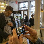 A visitor tries out a Pixel 3 smartphone in the Google Hardware Store in the Soho neighborhood of New York on its grand opening day, Thursday, October 18, 2018. The store displays a variety of products from Google such as Google Home appliances and the new Pixel 3 smartphones and provides experiential shopping for customers. (ÂPhoto by Richard B. Levine)