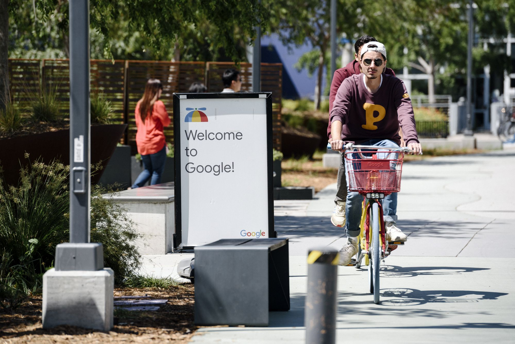 MOUNTAIN VIEW, CA - MAY 01: People ride bikes past signage on the Google campus as Google workers inside hold a sit-in to protest sexual harassment at the company, on May 1, 2019 in Mountain View, California. (Photo by Michael Short/Getty Images)