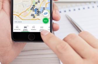 Uber Rival Grab Said to Be Raising $2 Billion From SoftBank, China's Didi